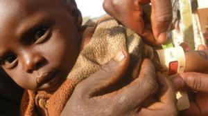CAFOD partners assess a baby for malnourishment