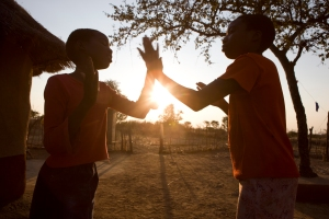 Zimisozettu, 10yrs (left) and her friend Melody, 11yrs, playing a clapping game