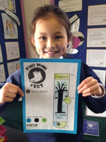 Ellie with her design, which features the Scales of Justice