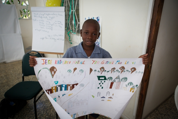 Young boy from Haiti who was part of a schools rehabilitation and education programme. He won a competition for the best DRR poster