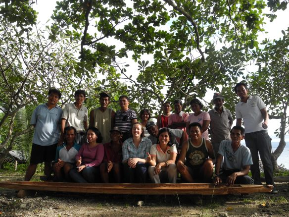 Kate Crowley in the centre with fisherfolk boat building in the Philippines post-Typhoon Washi that struck in 2012