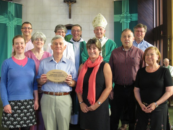 The Live SImply steering group with their plaque