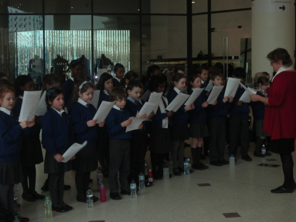 St Joseph's School choir singing St Joseph's Church at a CAFOD group fundraiser.