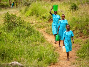3 girls carrying water before school-Uganda Lent