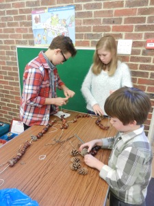 Having fun making rosaries out of conkers