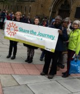 CAFOD volunteers on their way to a Share the Journey walk to show their Solidarity with Refugees