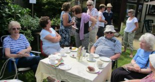Parishioners from St Stephen are enjoying cakes and tea at Frida Vine's garden party to raise funds for CAFOD