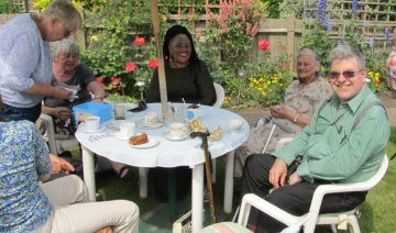 Parishioners for St Stephen in Bexley enjoying Frida and John Vine's garden party