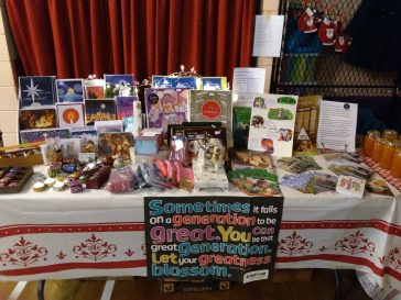 Anne's table at her Parish's Christmas market, full of World Gift information!