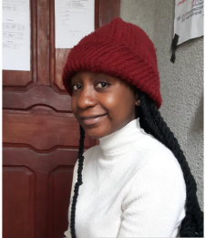 Melissa, who has learned to read and write, and completed Primary and Secondary school with the help of CAFOD!
