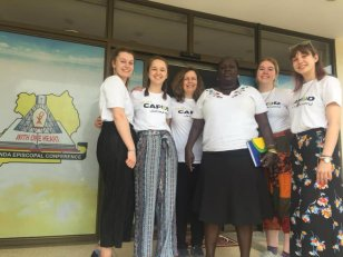 Nicole Gillespie on her way to Uganda. She is from the right.