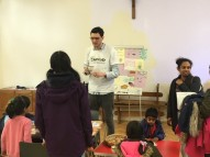 Parish volunteer talking to his fellow parishioners during the soup lunch.