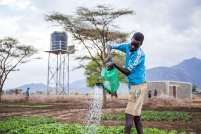 Fabiano next to the solar powered water pump