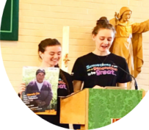 Girls speaking at Mass for CAFOD